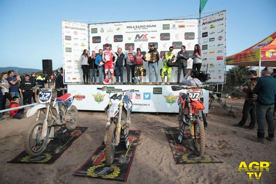 Pietro Razzini (#44) ed Andrea Bonacorsi (#32) sul podio della classe 125cc